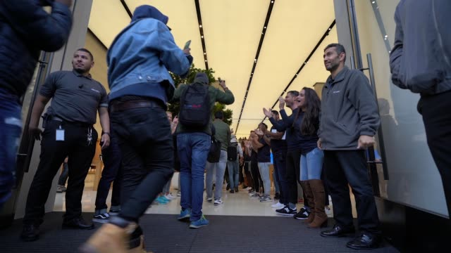customers enter the apple store at the launch of the new iphone at apple store, regent street on september 21, 2018 in london, england. - new stock videos & royalty-free footage