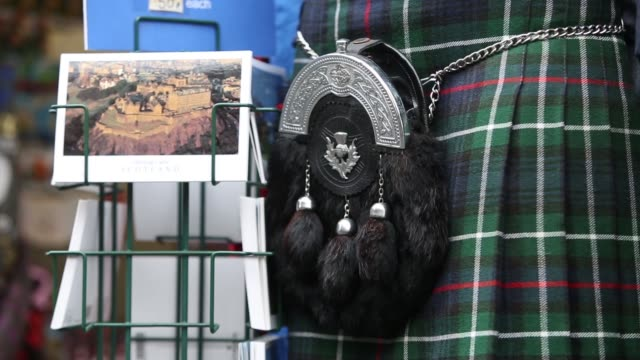 customers exit a scottish souvenir store on the day of the scottish independence referendum vote, in edinburgh, u.k., on thursday, sept. 18 tartan... - scottish culture stock videos & royalty-free footage
