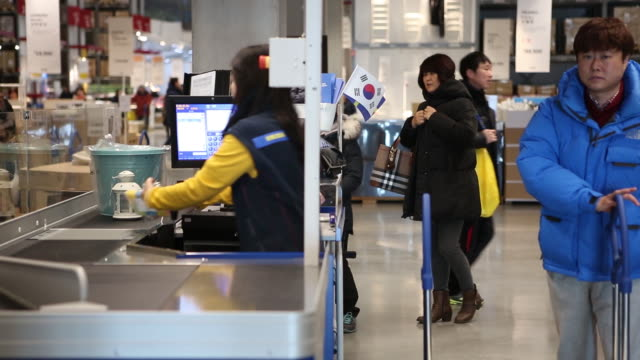 customers gather their purchases at checkout counters of an ikea ab store in gwangmyeong gyeonggi province south korea on thursday dec 18 an ikea ab... - kyonggi do province stock videos and b-roll footage
