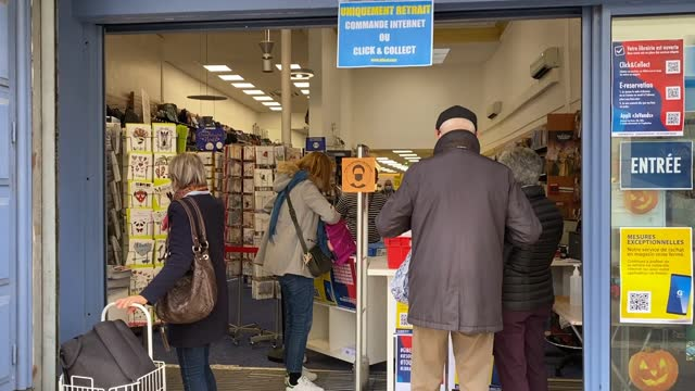 customers get their click and collect orders at gibert joseph bookstore on november 10, 2020 in saint german en laye, france. bookstores like many... - book shop stock videos & royalty-free footage