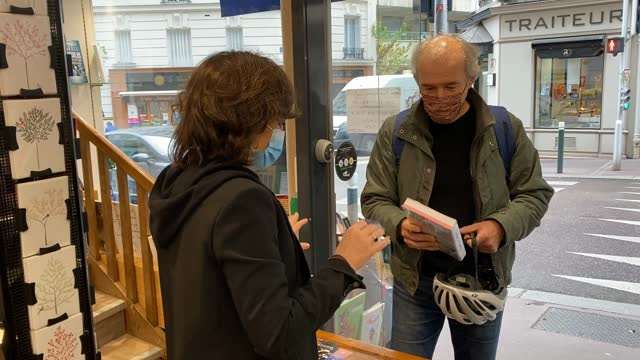 customers get their click and collect orders at paroles bookstore on november 10, 2020 in saint mande, france. bookstores like many other small... - book stock videos & royalty-free footage
