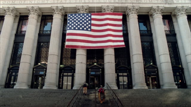 tl la ws customers going up and down steps of post office with large american flag hanging down/ new york city - united states postal service stock videos & royalty-free footage
