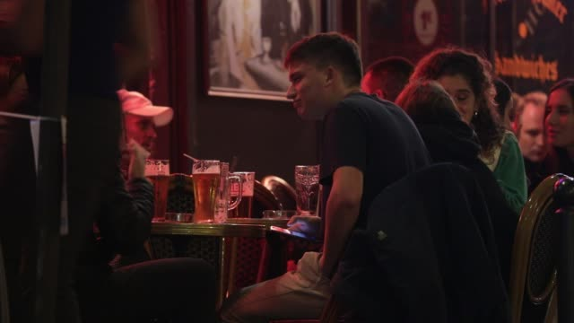 customers have a nightcap in a bar of the latin quarter on october 5 2020 in paris france to fight against the covid19 the paris police prefecture... - nightwear stock videos & royalty-free footage