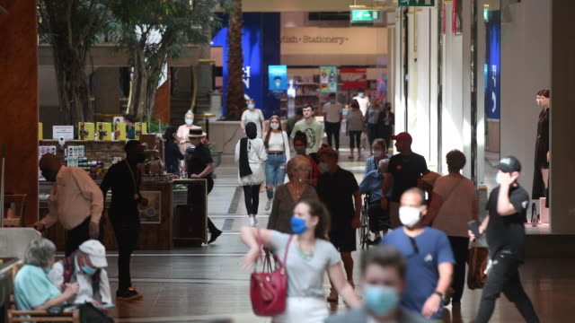 customers in face masks walk through the trafford centre shopping mall, operated by intu properties plc, in manchester, u.k., on tuesday, sept. 15,... - indoors stock videos & royalty-free footage