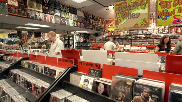 ws ts customers in record store digging through bins of second hand vinyl records and cds / palm desert, california, usa - second hand stock videos & royalty-free footage
