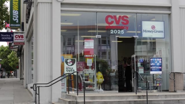 customers leave a cvs caremark store in san francisco / exteriors and signage cvs exteriors on august 04, 2011 in san francisco, california - cvs caremark stock videos & royalty-free footage
