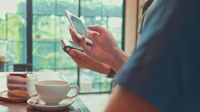 customers make a contactless payment via mobile phone at cafe coffee shop and restaurant - radio frequency identification stock videos & royalty-free footage