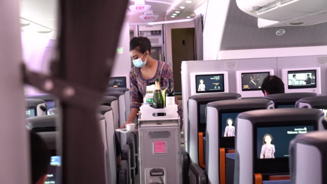 customers of singapore airlines arriving to airbus se a380 transformed temporarily to restaurant, offering dishes from its menu, two complimentary... - crew stock videos & royalty-free footage