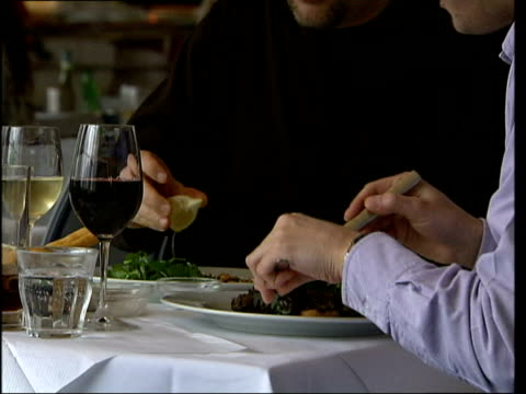 customers opinions on london restaurants itv london river cafe int music overlay sequence of food being prepared served and eaten inside a restaurant... - itv london tonight点の映像素材/bロール