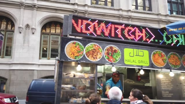 customers order food from street vendors in zuccotti park during the lunch hour in lower manhattan, april 12, 2019 in new york city. new proposed... - unhealthy eating stock videos & royalty-free footage