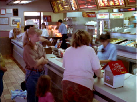 t/l ms customers ordering food in line at mcdonald's counter / reno, nevada, usa - ファーストフード点の映像素材/bロール