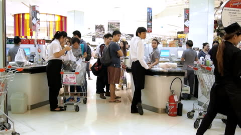 customers paying for goods at the check counter in supermarket - waiting stock videos & royalty-free footage