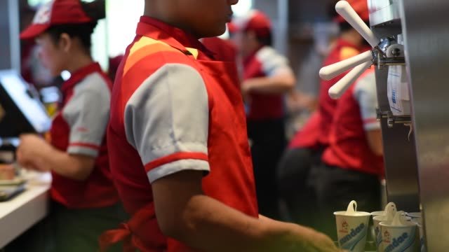 customers place orders at a jollibee foods corp restaurant in the bonifacio global city triangle area of manila the philippines on saturday oct 21 an... - take away food stock videos & royalty-free footage