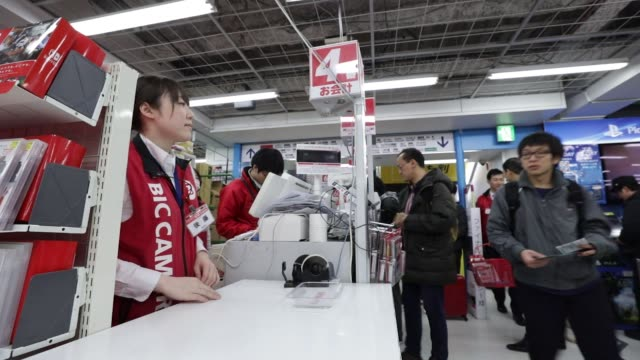 customers purchase nintendo co. switch game consoles at a bic camera inc. electronics store in tokyo, japan, on friday, march 3 customers browse... - switch stock videos & royalty-free footage