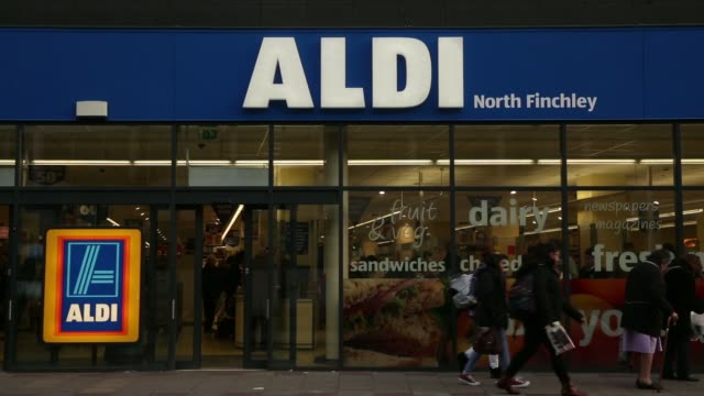 customers push a shopping cart of purchased products through the exit of an aldi einkauf gmbh supermarket in london uk on monday jan 20 general views... - push cart stock videos & royalty-free footage