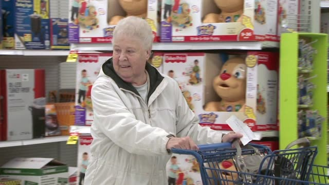WXMI Customers pushing shopping carts and shopping in a store on December 26 2012 in Grand Rapids Michigan