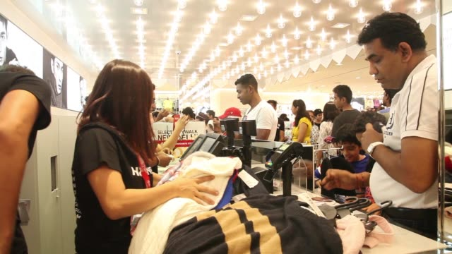 Customers queue at the checkout counter of the Hennes Mauritz AB store in Select Citywalk mall in the Saket area of New Delhi India on Friday Oct 2...