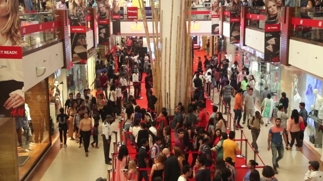 Customers queue for the opening of a Hennes Mauritz AB store in Select Citywalk mall in the Saket area of New Delhi India on Friday Oct 2 A customer...