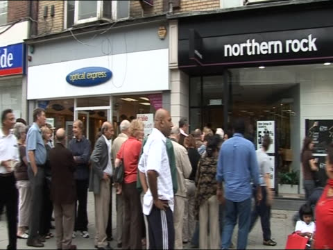 customers queue outside a branch of northern rock waiting to withdraw their savings during run on bank 16 november 2007 - 2007 stock videos and b-roll footage