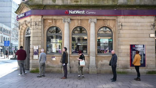 customers queue outside a natwest bank practising social distancing on march 25 in cardiff wales the coronavirus pandemic has spread to many... - social distancing stock videos & royalty-free footage