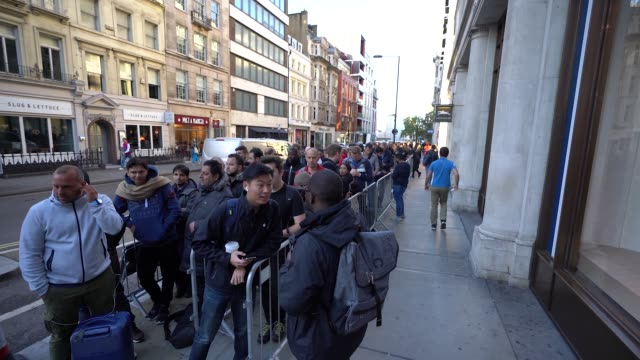 customers queue outside the apple store in anticipation for the launch of the new iphone at apple store, regent street on september 21, 2018 in... - waiting in line stock videos & royalty-free footage