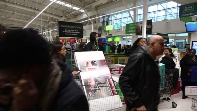 customers queue outside the black friday discount sale at an asda supermarket, operated by wal mart stores inc, in the wembley district of london,... - black friday stock videos & royalty-free footage