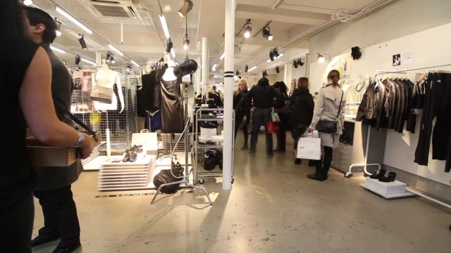 Customers queue to enter the new Other Stories store operated by Hennes Mauritz AB on the launch day in London UK Shoppers walk through Other Stories...
