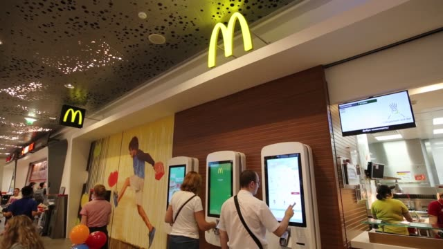 customers queue to make their food orders at the service counter at mcdonald's corp.'s 505th russian fast food restaurant on its opening day at the... - fast food stock-videos und b-roll-filmmaterial