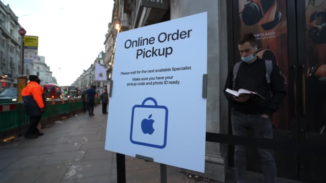 customers queuing for the latest iphone socially distance as they wait to enter the store on october 23, 2020 in london, england. apple's latest 5g... - handheld stock videos & royalty-free footage