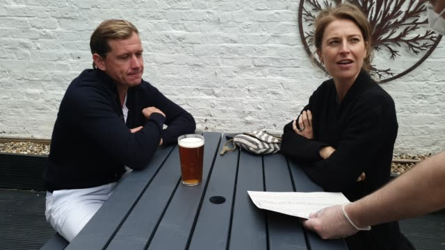 customers receive and order drinks at the lordship pub, east dulwich on july 4, 2020 in london, england. the uk government announced that pubs,... - brian dayle coronavirus stock videos & royalty-free footage