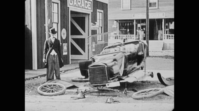 1920 a customer's rental car falls apart - silent film stock videos & royalty-free footage