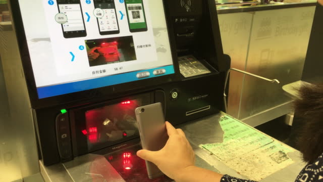 customers scan the commodities on the machine and pay with alipay or wechat payment - self service stock videos & royalty-free footage