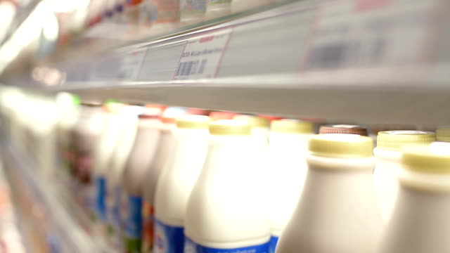 customers select milk in supermarket - lactose fermentation stock videos & royalty-free footage