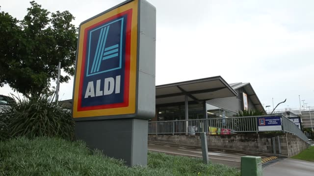 customers shop and pick up groceries in an aldi stores ltd food store in sydney australia on thursday june 25 2015 shots wide shot of produce section... - wide stock videos & royalty-free footage