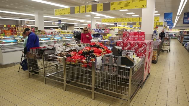 customers shop and pick up groceries in an aldi stores ltd food store in sydney australia on thursday june 25 2015 shots wide shot of customers at... - wide stock videos & royalty-free footage