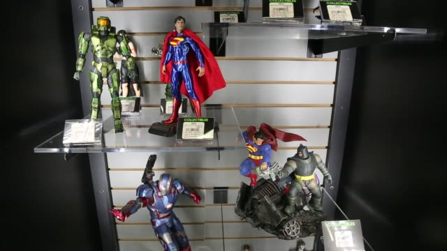 customers shop at a gamestop corp store in new york us on wednesday nov 18 2015 photographer michael nagle bloomberg shots close up shots of a shelf... - figurine stock videos & royalty-free footage