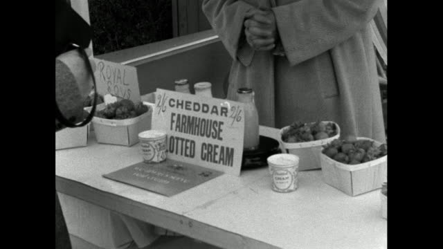 customers shop at strawberries and cream stall; 1976 - 1957 stock videos & royalty-free footage