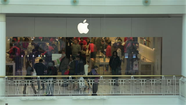 Customers shop at the Apple Store at Pentagon City Mall on December 26 2013 in Arlington VA