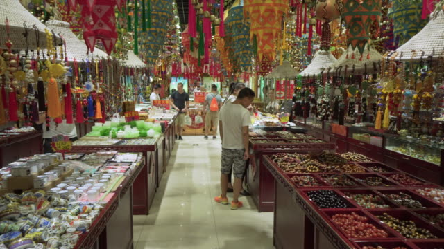 customers shopping for decors arranged at supermarket - beijing, china - cupboard stock videos & royalty-free footage
