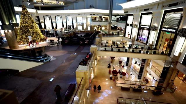 customers shopping in the taipei 101 building near christmas, taipei, china - taipei 101 stock videos & royalty-free footage