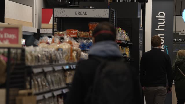 customers shopping inside the amazon fresh store on march 4, 2021 in the ealing area of london, england. shoppers at the amazon fresh store, which... - shop stock videos & royalty-free footage