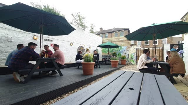 customers sit at tables as they use social distancing at the lordship pub, east dulwich on july 4, 2020 in london, england. the uk government... - brian dayle coronavirus stock videos & royalty-free footage