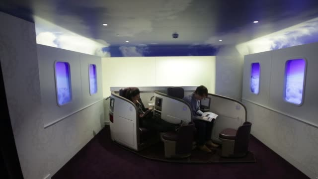 customers sit in armchairs inside a virgin money lounge, operated by virgin money holdings plc, in london, u k, on monday, nov 17 customers sit in... - plc stock videos & royalty-free footage