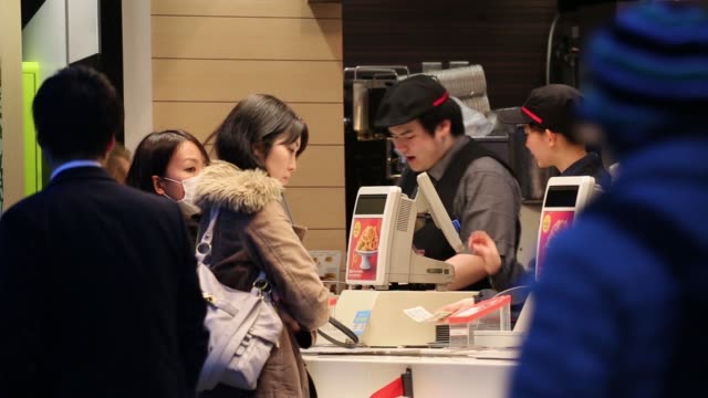 customers sit inside a mcdonald's restaurant operated by mcdonald's holdings co japan ltd in tokyo at night employees serve customers at a mcdonald's... - mcdonald's stock videos & royalty-free footage