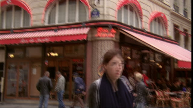 customers sit under the awning of the bar du marche in paris, france. - awning stock videos and b-roll footage