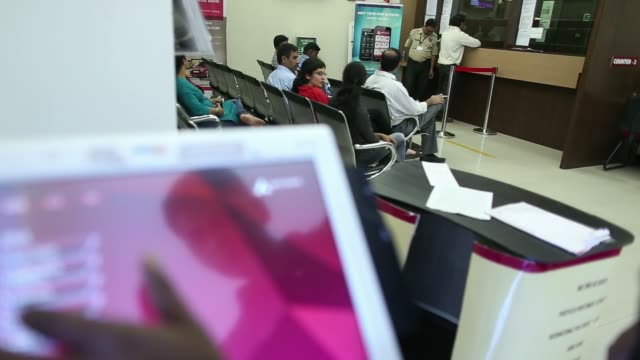 customers sit waiting to deposit money inside an axis bank ltd. branch in mumbai, india, on thursday, jan. 16 an axis poster sits on display as a... - branch stock videos & royalty-free footage