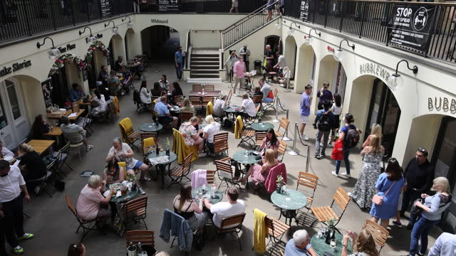 customers sitting at tables on square inside covent garden market owned by shaftesbury plc, who have noted an increase in demand for empty commercial... - fashionable stock videos & royalty-free footage