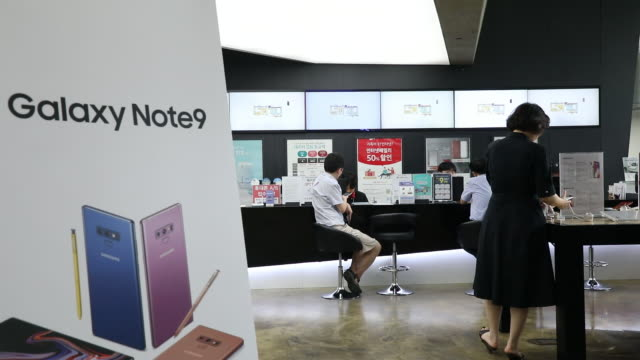Customers try out Samsung Electronics Co Galaxy Note 9 smartphones at KT Corp's KT Square flagship store in Seoul South Korea on Monday August 2018
