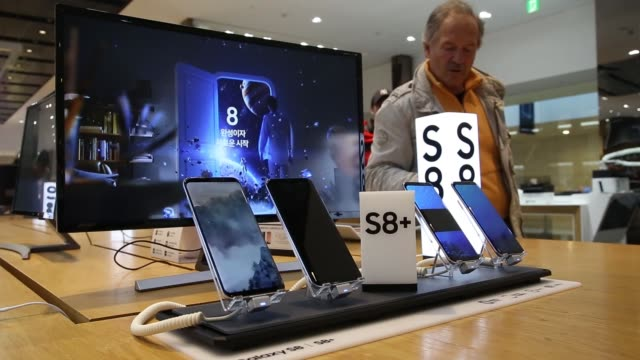 Customers try out Samsung Electronics Co Galaxy S8 smartphones at the company's D'light flagship store in Seoul South Korea on Monday April 3 An...