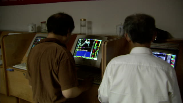 customers view data on computer monitors, china. available in hd. - graph stock videos & royalty-free footage